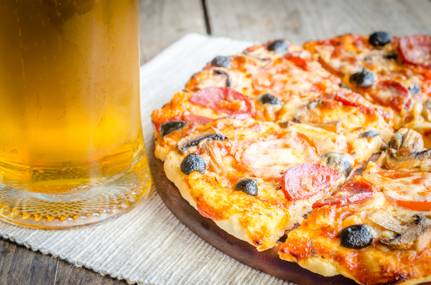 Homemade pizza with a glass of beer