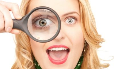 woman with magnifying glass